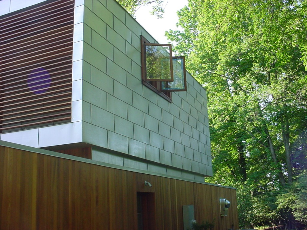 Residential project with metal siding fabricated and installed by our metal roofing specialists