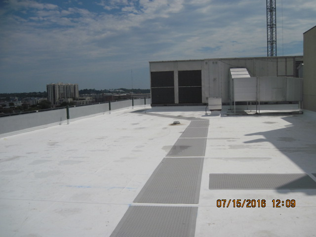 New TPO roof installation with walkway pads