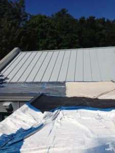 New coating being installed on a roof restoration project