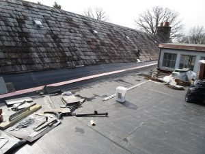 EPDM reroofing with a slate roof tie in
